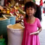 Siem Reap market - the cutest rice girl...