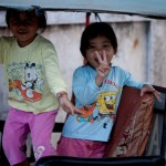 Two kids in a tuk tuk